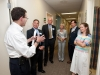 Joseph Feiner, Medical Practice Manager at Kennedy CHC, gives a tour of the Health Center to guests