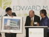 Marty Cohen, President of the MetroWest Health Foundation, receives a photo of Waverly Street